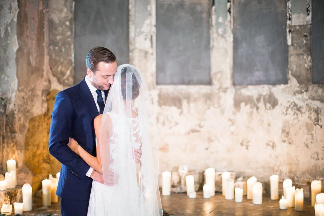 bride and groom kissing at experiential wedding The Asylum London