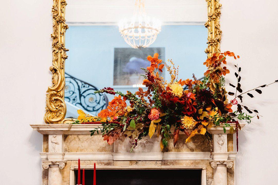 autumn wedding styling fall flowers on fireplace London wedding