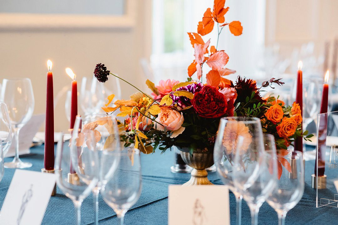 autumn wedding styling candles on table with autumn flowers