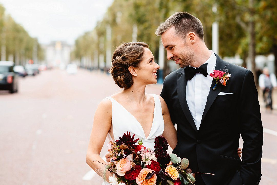 bride and groom on The Mall for first look autumn wedding styling tips