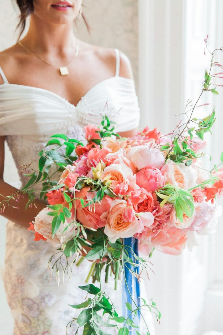 peony wedding bouquet being held by bride
