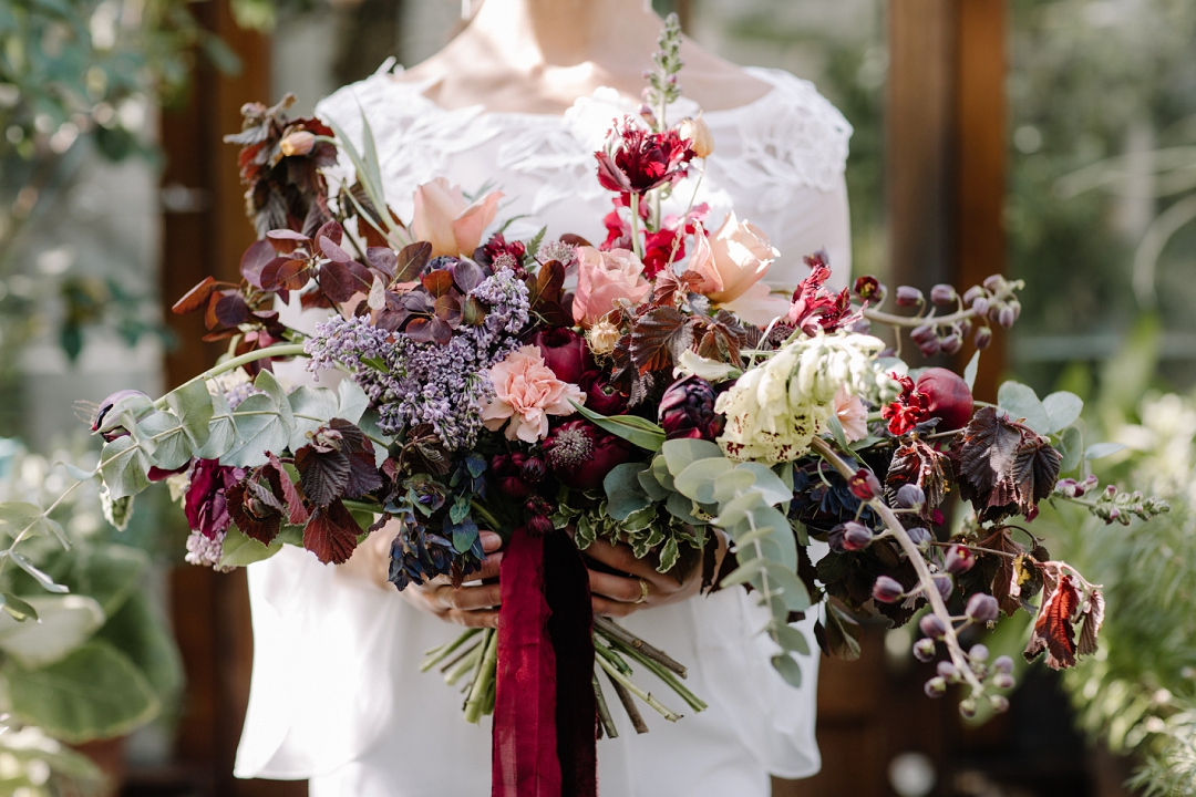 oversized bouquet in deep reds and blsuh pinks
