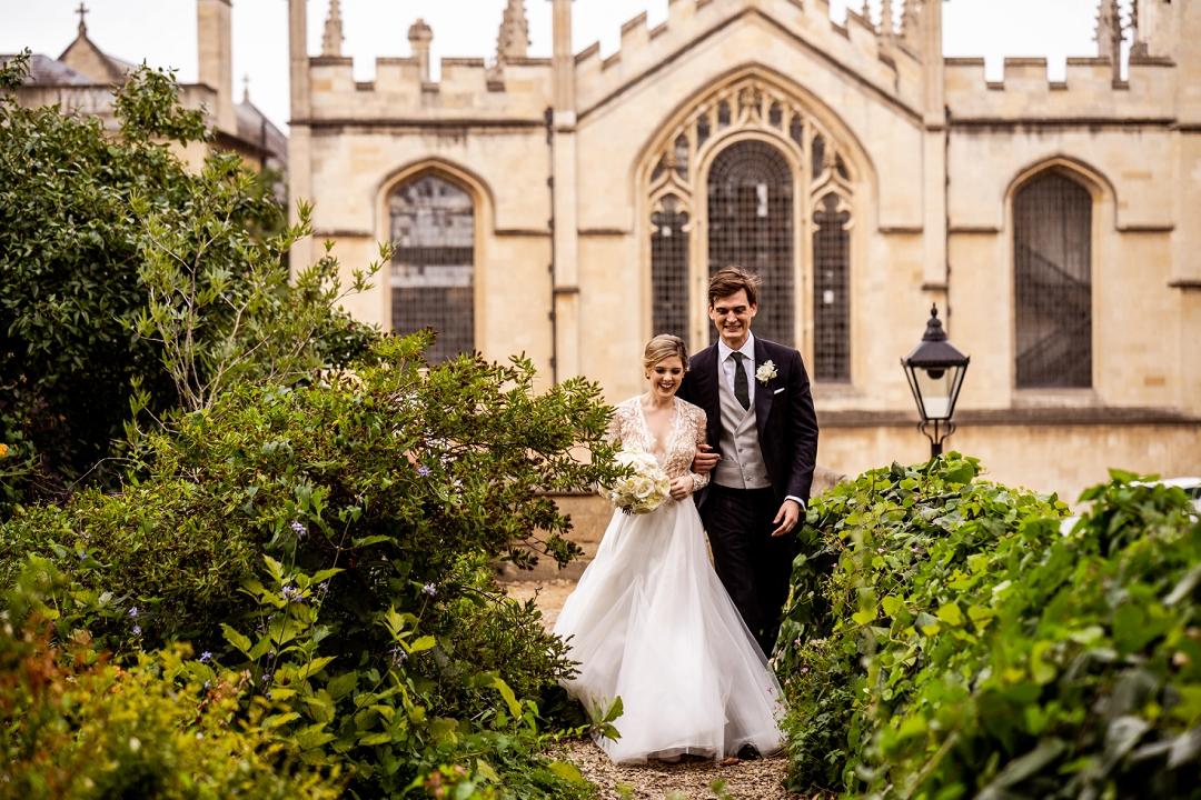 bride and groom walking in Oxford