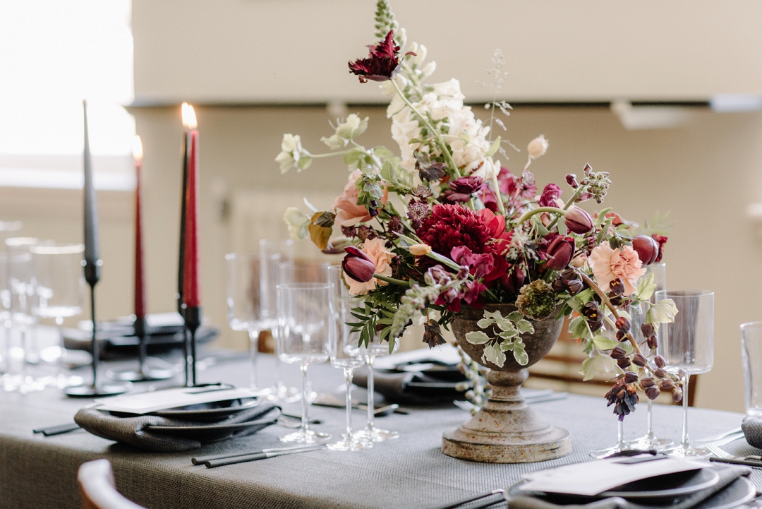 wedding tablescape with grey blcak details and red blush flower