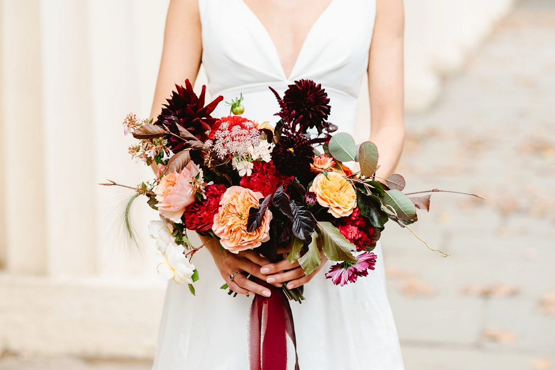 Autumn wedding bouquet with roses, dahlias and smoke leaf, with trailing natural dyed silk ribbons Fiona Kelly Photography