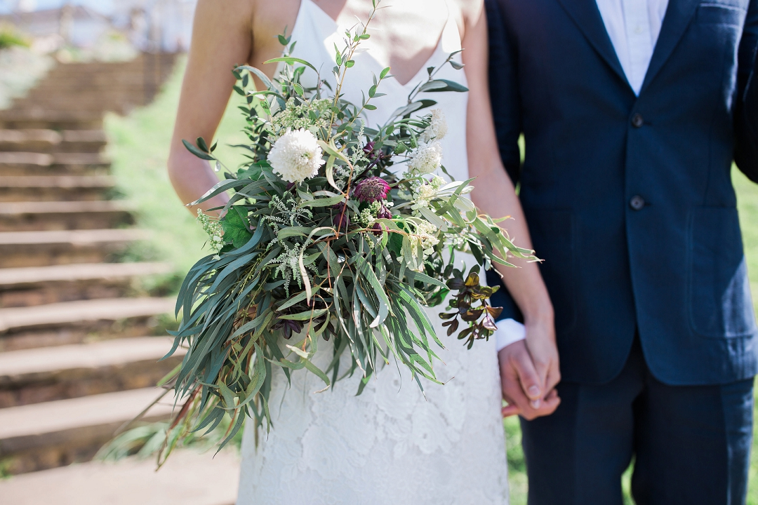 Winter foliage bouquet with willow eucalyptus and olive with white flowers. Siobhan H Photgraphy